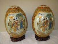 Pair of Oriental Satsuma Decorative Eggs with wooden bases excellent condition