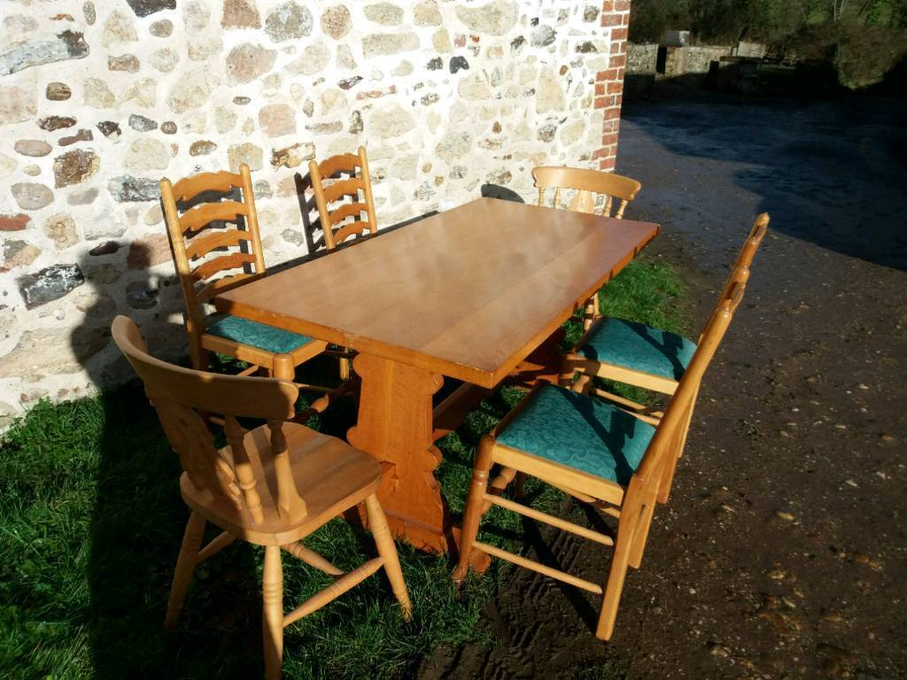 Long pine trestle table with 6 chairs | in Exeter, Devon | Gumtree