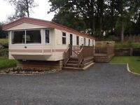 ABI Brisbane Double Glazed & Central Heated 37x12 3 Bedroom Static caravan for sale with wooden deck