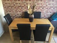 Oak dining table with 5 brown faux leather chairs