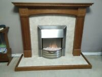 marble fireplace and solid wood surround