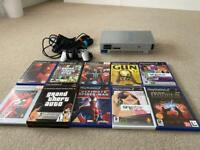 PlayStation 2 Silver bundle - controller, games, Singstar mics x 2