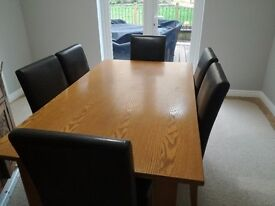 Oak veneered dining table 6 places, good condition (will throw in chairs)