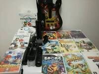 Nintendo Wii with Boxed Mario kart, guitar hero and accessories