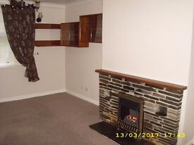 Unfurnished 2 double bedroom house in town centre.