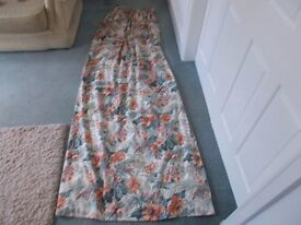 A pair of Crowson's made to measure lined floral curtains to fit a patio door.