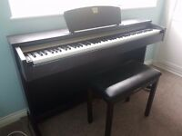 Yamaha Clavinova CLP 320 digital piano with matching stool.