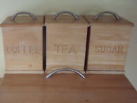 Matching light wood coffee, tea & sugar caddies, canisters, liners, brushed steel handles. £2 lot