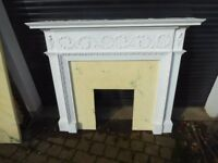 White fibreglass fireplace surround with hearth.