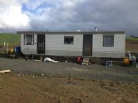 2 bedroom mobile home with built in wardrodes,leather sofa,woodburning stove,shower,gas oven.