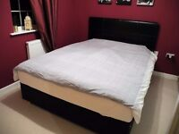 Luxury Divan bed base with four storage drawers and a dark brown headboard (almost new)