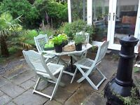 Hardwood painted patio table and 4 chairs,free for collection.