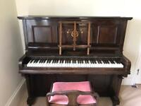 Upright piano by George F Smith with piano stool