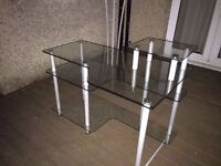 Nice and clean computer table with 4 glass pates.