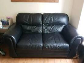 2 two seater black sofas