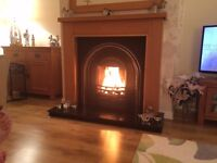 Oak surround with Back and black marble hearth in beautiful condition and well looked after