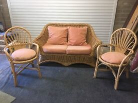 Quality cane sofa and 2 chairs spare matching fabric