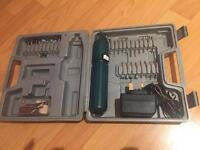 Hand held cordless drill with charger and accessories.