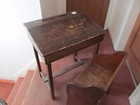 Old fashioned school desk complete with matching chair.
