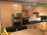 Full kitchen units, worktops, integrated appliances with breakfast bar