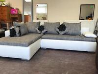 White leather and grey fabric corner sofa