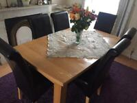 Extendable Dinning table with 4 leather chairs