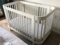 Stylish Dreema Cot with adjustable base for 2 positions