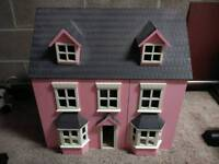 Dolls house with loads of dolls and furniture