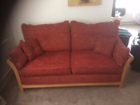Three seater settee terracotta colour with footstool