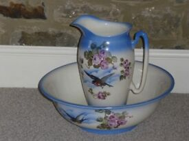 Jug and bowl set with attractive design featuring wild birds and roses