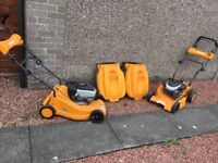 Two partner petrol lawnmowers, one is self propelled, both working