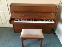 Loved family piano. Excellent condition and tuned regularly. Includes matching stool.