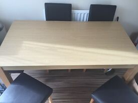 Dining Table and 6 Brown Chairs.
