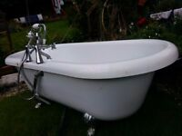 Freestanding Rolltop bath with claws feet and mixer tap