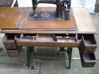 Vintage singer sewing machine on a treadle table