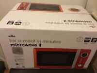 New and still in box, red Wilko microwave