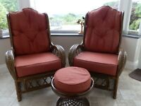 Pair of cane, upholstered chairs and 1 footstool