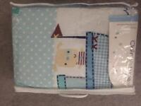 Brand new cot bumper and quilt set