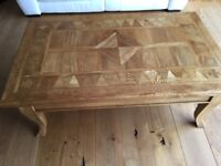 Solid wood coffee table with marquetry top