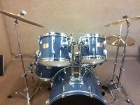 Retired Drum teacher has a Pearl Export 'Fusion' drum kit with Paiste cymbals & drum bags for sale.
