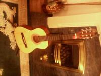 lovely half size guitar,stand and tuner.