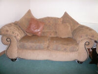 Immaculate 2 seater sofa and armchair with golden and embroidered fabric. Dark wooden feet.