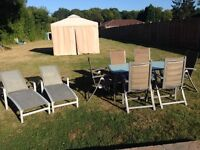 Sun loungers and table with 6 chairs