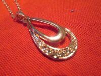Pendant with faux diamonds