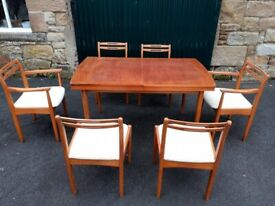 Retro 70s extending dining table with six chairs