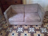 medium size modern sofa in excellent condition can deliver