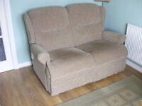 Two seater sofa excellent condition, seperates into two