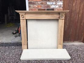 Wooden fireplace mantel surround with tiled back and hearth