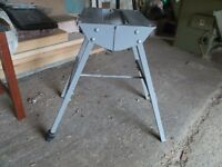 A Small unused metal folding bench with 1 adjustable leg