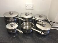 Set of six Stellar stainless steel saucepans